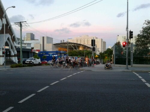 Brisbane Style Over Speed Riders stopped at the lights before entering Musgrave Park